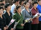 Severokorejci v rámci oslav 69. výročí založení Korejské dělnické strany...