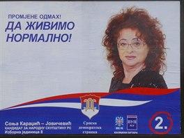 """Předvolební billboard Sonji Karadžič-Jovičevič ve městě Pale s heslem """"Abychom..."""