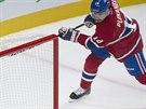 Tomáš Plekanec z Montrealu skóruje proti Henriku Lundqvistovi z NY Rangers.