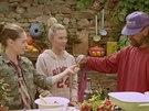 Pomocník Jim ochutnává páivou papričku, kterou vypěstovala Kateřina. Podle jeho...