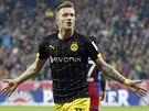 PŘEKVAPIVÉ VEDENÍ. Marco Reus z Dortmundu se raduje ze svého gólu, který vstřelil v utkání na hřišti Bayernu Mnichov.