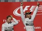 RADOST A ROZPAKY. Lewis Hamilton září po triumfu ve Velké ceně USA, druhý Nico