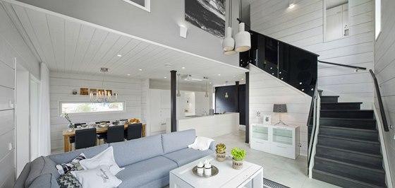Interiér je zařízený v typicky skandinávských barvách.