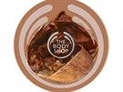 Tělové máslo Cocoa Butter zn. The Body Shop s hutnou texturou vyživuje pokožku celého těla a zanechává sladce kakaovou vůni. Info o ceně v obchodech