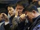 Příbuzní obětí z potopeného trajektu Sewol na zadání korejského parlamentu 7. listopadu 2014