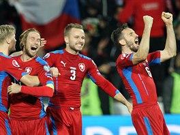 ČESKÁ RADOST. Zleva Václav Procházka, Jaroslav Plašil, Michal Kadlec a Tomáš Sivok slaví gól proti Islandu.