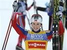 Marit Björgenová se raduje a usmívá, v po vítězství v minitour v Lillehammeru.