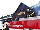 Požár likvidovalo sedm jednotek hasičů. (4. prosince 2014)
