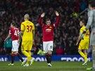 DÍKY ZA VAŠE OVACE. Útočník Manchesteru United Wayne Rooney (uprostřed) slaví gól do sítě Liverpoolu.