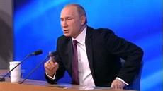 Ruský prezident Vladimir Putin na tiskové konferenci hodnotící rok 2014. (18....