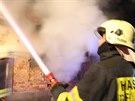 Požár rodinného domu v Dobrochově na Prostějovsku (28. prosince 2014).